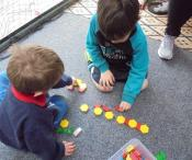 children building with construction shapes