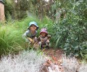 kids hiding in the garden